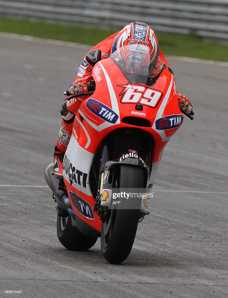Ducati MotoGP rider Nicky Hayden of the US accelerate on the back straight on the third day of the pre-season MotoGP test session at the Sepang circuit outside Kuala Lumpur on February 28, 2013. AFP PHOTO / Peter LIM