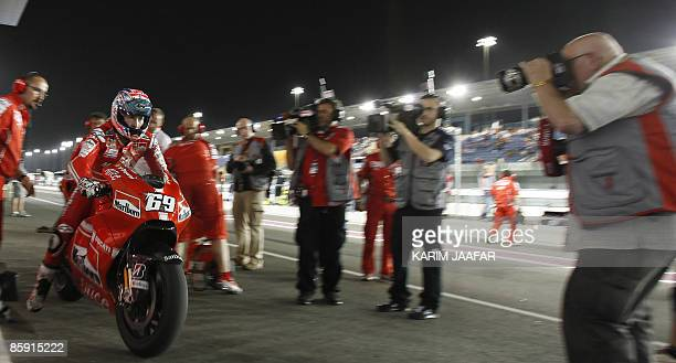 Ducati MotoGP rider Nicky Hayden of the US vies for the pole position at Losail International Circuit near Doha on April 11 2009 AFP PHOTO/KARIM...