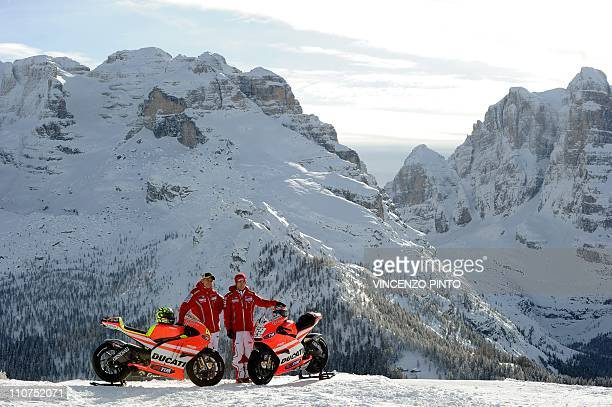 Ducati new rider Italian Valentino Rossi and team mate US Nicky Hayden pose on January 12 during the official presentation of the new moto Ducati...