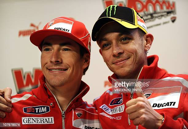 Ducati new rider Italian Valentino Rossi poses with team mate US Nicky Hayden on January 11 2011 prior a press conference as part of the 'Vroom 2011...