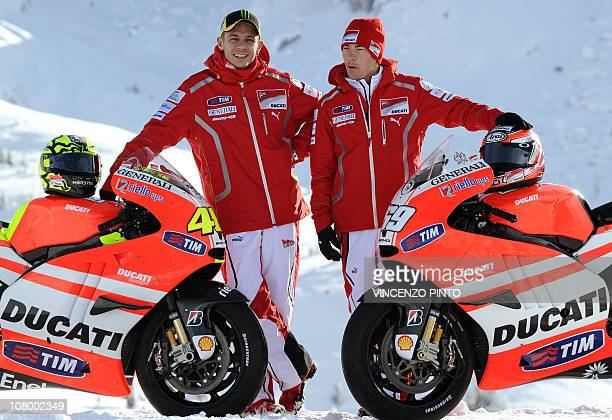 Ducati new rider Italian Valentino Rossi poses with team mate US Nicky Hayden on January 12 during the official presentation of the new moto Ducati...