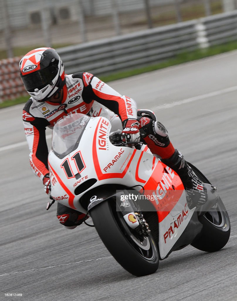 Ducati Parmac rider Ben Spies of the US ride his bike on turn one on the third day of the pre-season MotoGP test session at the Sepang circuit outside Kuala Lumpur on February 28, 2013. AFP PHOTO / Peter LIM