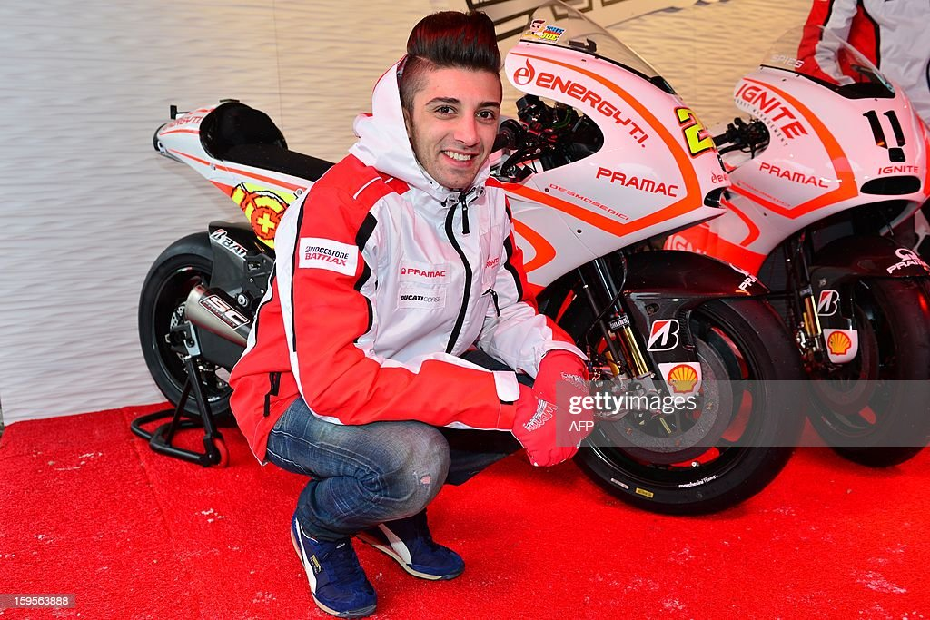 Ducati Pramac rider Andrea Iannone poses beside new Ducati motorbikes during the Wrooom, F1 and MotoGP Press Ski Meeting, Ducati and Ferrari's annual media gathering, in Madonna di Campiglio on January 16, 2013. AFP/ GIUSEPPE