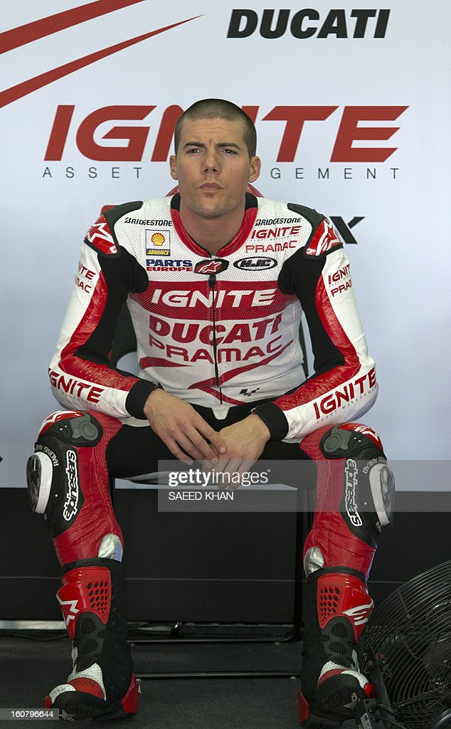 Ducati Pramac rider Ben Spies of the US rests after the second day of the pre-season MotoGP test at the Sepang circuit in Sepang outside Kuala Lumpur on February 6, 2013. AFP PHOTO / Saeed Khan