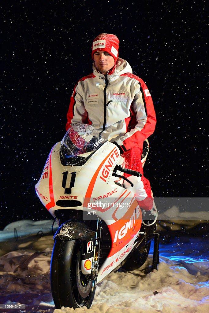 Ducati Pramac rider Ben Spies pose on a new Ducati racing motorbike during the Wrooom, F1 and MotoGP Press Ski Meeting, Ducati and Ferrari's annual media gathering, in Madonna di Campiglio on January 15, 2013.
