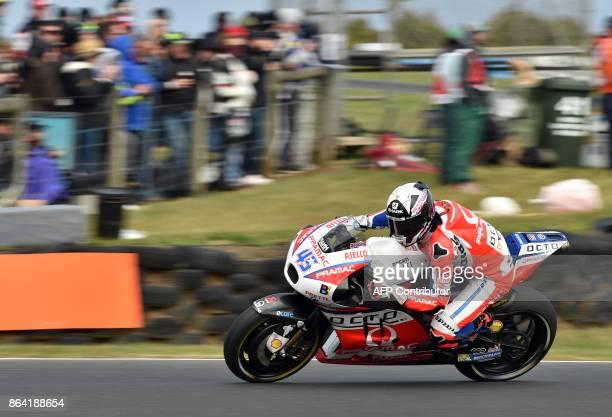 Ducati Pramac rider Scott Redding of Britain powers his machine during the qualifying session of the Australian MotoGP Grand Prix at Phillip Island...
