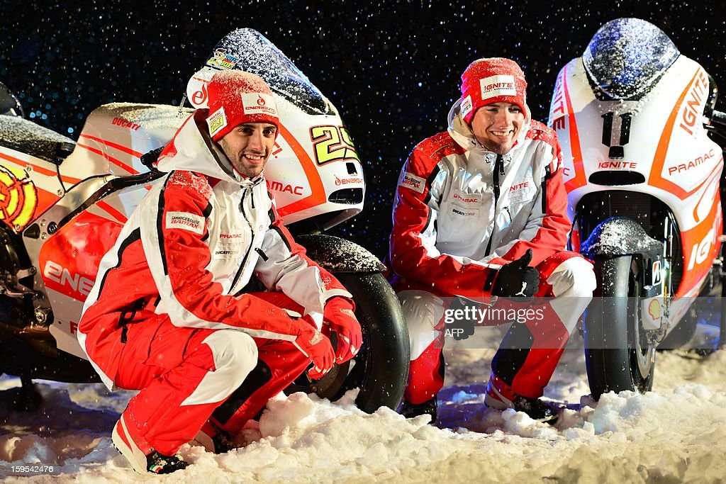 Ducati Pramac riders Vittorio Iannone (L) and Ben Spies pose near new Ducati racing motorbikes during the Wrooom, F1 and MotoGP Press Ski Meeting, Ducati and Ferrari's annual media gathering, in Madonna di Campiglio on January 15, 2013. AFP PHOTO / GIUSEPPE CACACE