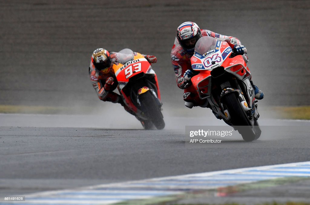 Ducati rider Andrea Dovizioso of Italy (R) leads Honda rider Marc Marquez of Spain (L) during the MotoGP Japanese Grand Prix at Twin Ring Motegi circuit in Motegi, Tochigi prefecture on October 15, 2017. /