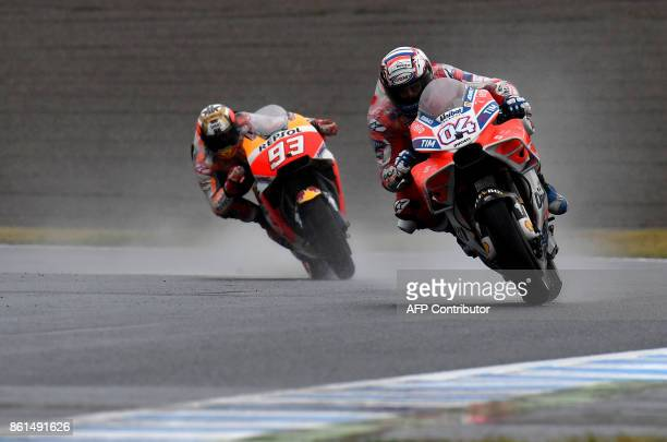 Ducati rider Andrea Dovizioso of Italy leads Honda rider Marc Marquez of Spain during the MotoGP Japanese Grand Prix at Twin Ring Motegi circuit in...