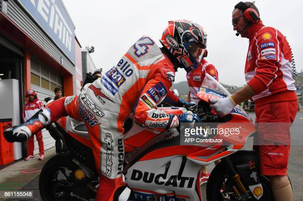 Ducati rider Andrea Dovizioso of Italy leaves his pit during the fourth practice round of the MotoGP Japanese Grand Prix at Twin Ring Motegi circuit...