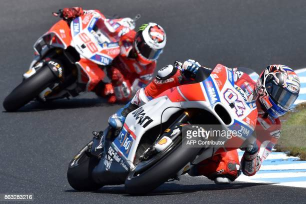 Ducati rider Andrea Dovizioso of Italy powers ahead of teammate Jorge Lorenzo of Spain during the first practice session of the Australian MotoGP...