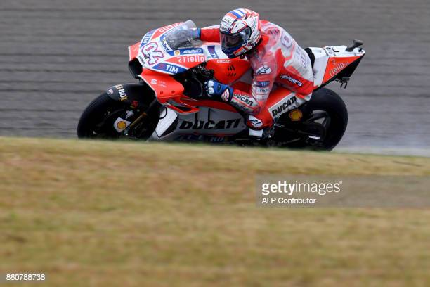 Ducati rider Andrea Dovizioso of Italy powers his machine during the second practice session of the MotoGP Japanese Grand Prix at Twin Ring Motegi...