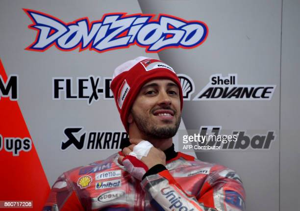 Ducati rider Andrea Dovizioso of Italy smile in his pit prior to the first practice round of the MotoGP Japanese Grand Prix at Twin Ring Motegi...