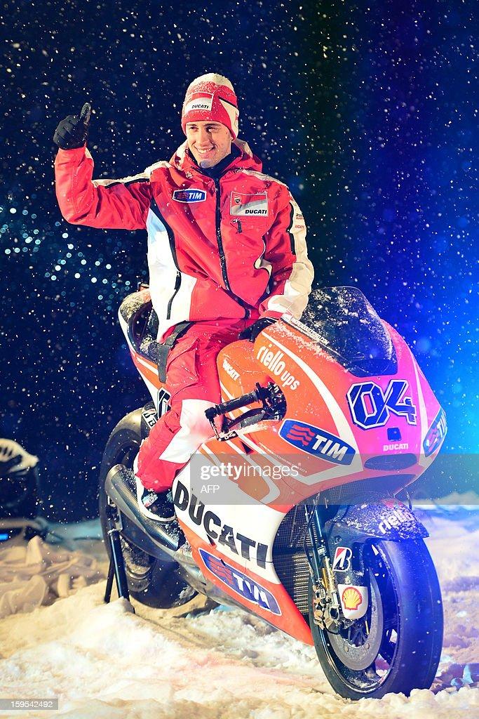 Ducati rider Andrea Dovizioso poses on a Ducati racing motorbike during the Wrooom, F1 and MotoGP Press Ski Meeting, Ducati and Ferrari's annual media gathering, in Madonna di Campiglio on January 15, 2013.