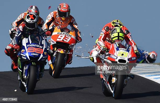 Ducati rider Andrea Iannone of Italy looks down as a seagull smashes into his bike on the opening lap of the MotoGP Australian Grand Prix at Phillip...