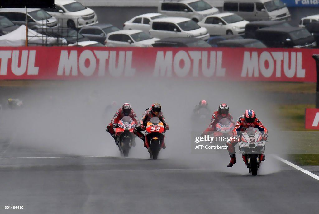 Ducati rider Danilo Petrucci of Italy (R) leads Ducati rider Andrea Dovizioso of Italy (L), Honda rider Marc Marquez of Spain (2nd L) and Ducati rider Jorge Lorenzo of Spain (2nd R) during the MotoGP Japanese Grand Prix at Twin Ring Motegi circuit in Motegi, Tochigi prefecture on October 15, 2017. /