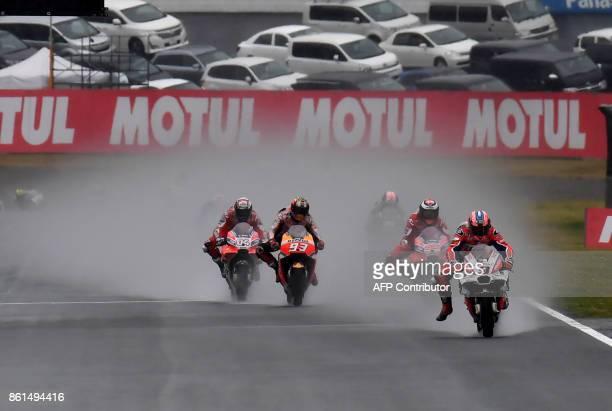 Ducati rider Danilo Petrucci of Italy leads Ducati rider Andrea Dovizioso of Italy Honda rider Marc Marquez of Spain and Ducati rider Jorge Lorenzo...