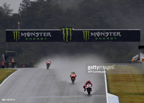 Ducati rider Danilo Petrucci of Italy leads Ducati rider Andrea Dovizioso of Italy and Honda rider Marc Marquez of Spain at the downhill straight...