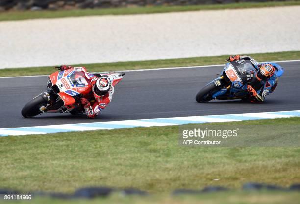 Ducati rider Jorge Lorenzo of Spain leads Honda rider Tito Rabat of Spain during the qualifying session of the Australian MotoGP Grand Prix at...