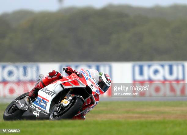 Ducati rider Jorge Lorenzo of Spain powers his machine during the third practice session of the Australian MotoGP Grand Prix at Phillip Island on...