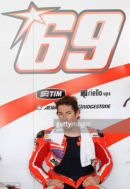Ducati rider Nicky Hayden of the US chats with his crew members in the garage on the second day of the preseason MotoGP test at the Sepang circuit...