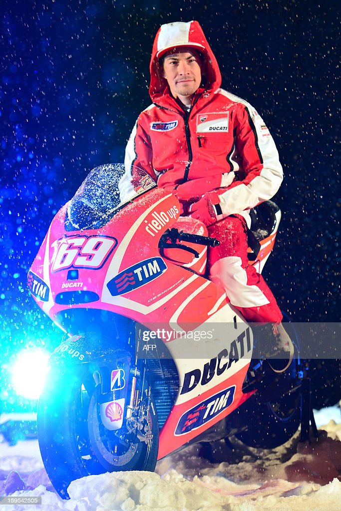 Ducati rider Nicky Hayden poses on a new Ducati racing motorbike during the Wrooom, F1 and MotoGP Press Ski Meeting, Ducati and Ferrari's annual media gathering, in Madonna di Campiglio on January 15, 2013.