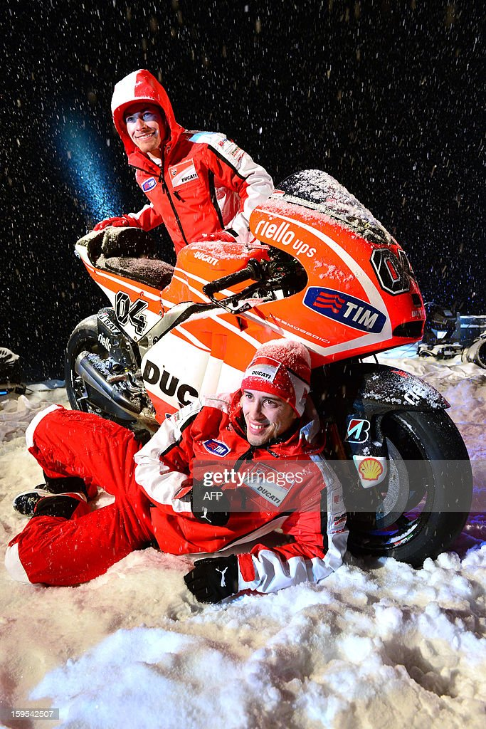Ducati riders Nicky Hayden (Top) and Andrea Dovizioso pose near a new Ducati racing motorbike during the Wrooom, F1 and MotoGP Press Ski Meeting, Ducati and Ferrari's annual media gathering, in Madonna di Campiglioon January 15, 2013. AFP PHOTO / GIUSEPPE CACACE