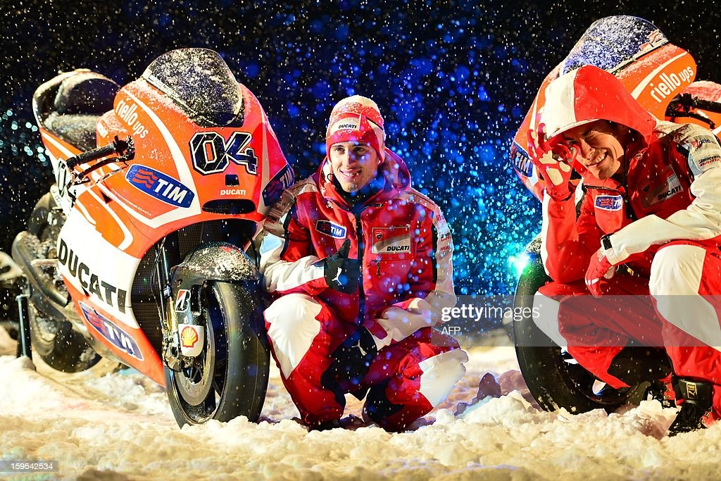 Ducati riders Nicky Hayden (R) and Andrea Dovizioso pose near new Ducati racing motorbikes during the Wrooom, F1 and MotoGP Press Ski Meeting, Ducati and Ferrari's annual media gathering, in Madonna di Campiglioon January 15, 2013.