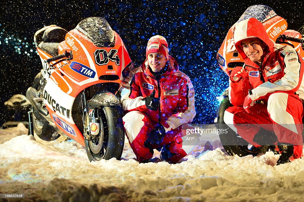 Ducati riders Nicky Hayden (R) and Andrea Dovizioso pose near new Ducati racing motorbikes during the Wrooom, F1 and MotoGP Press Ski Meeting, Ducati and Ferrari's annual media gathering, in Madonna di Campiglio on January 15, 2013.