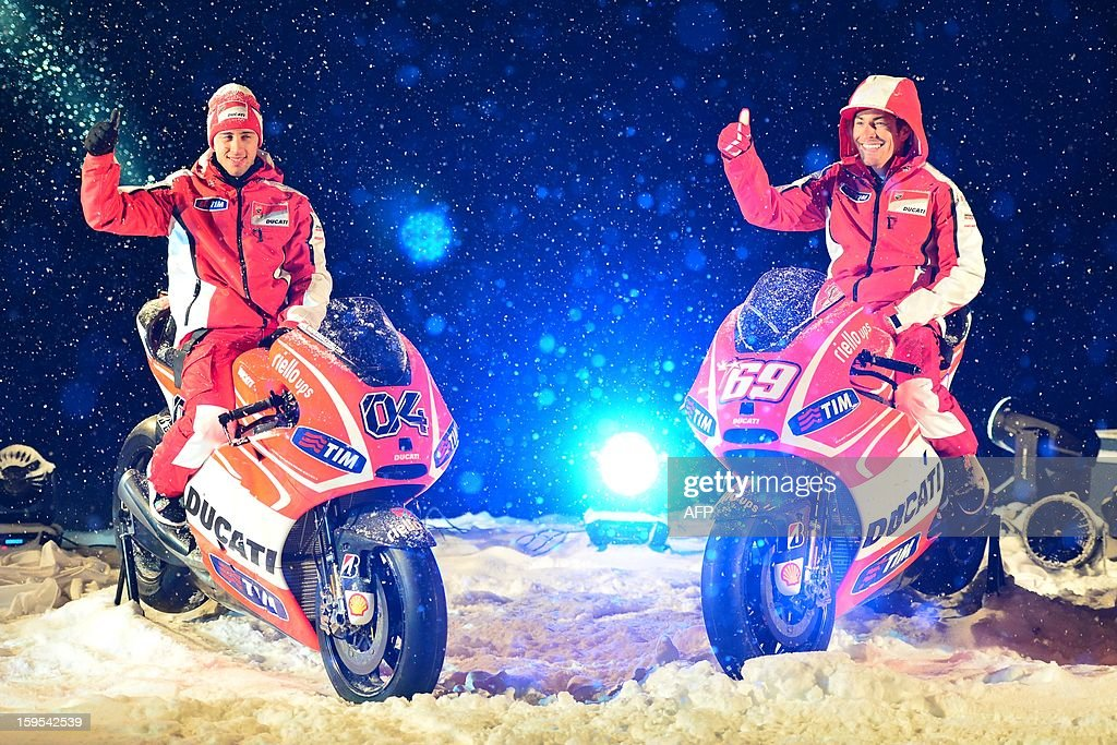 Ducati riders Nicky Hayden (R) and Andrea Dovizioso pose on new Ducati racing motorbikse during the Wrooom, F1 and MotoGP Press Ski Meeting, Ducati and Ferrari's annual media gathering, in Madonna di Campiglio on January 15, 2013.