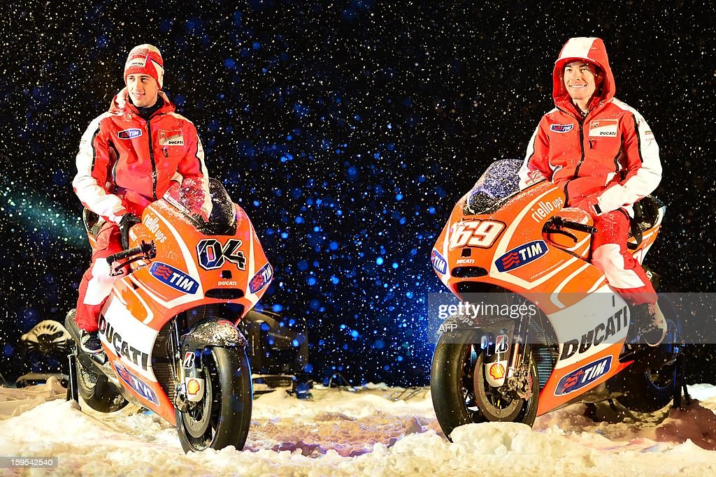 Ducati riders Nicky Hayden (R) and Andrea Dovizioso pose on new Ducati racing motorbikes during the Wrooom, F1 and MotoGP Press Ski Meeting, Ducati and Ferrari's annual media gathering, in Madonna di Campiglio on January 15, 2013.