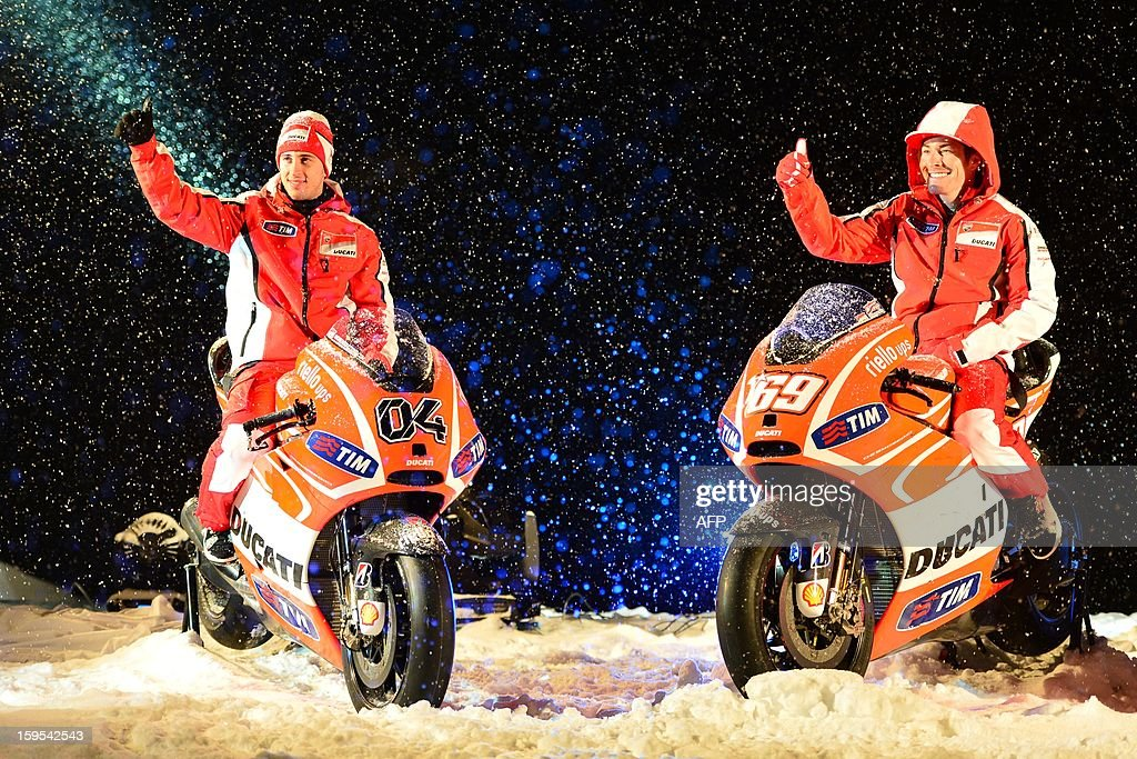 Ducati riders Nicky Hayden (R) and Andrea Dovizioso pose on new Ducati racong motorbikes during the Wrooom, F1 and MotoGP Press Ski Meeting, Ducati and Ferrari's annual media gathering, in Madonna di Campiglio on January 15, 2013.