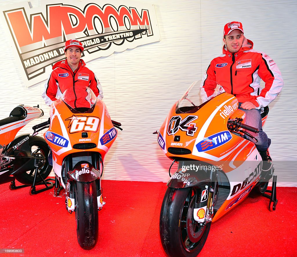 Ducati riders Nicky Hayden (L) and Andrea Dovizioso pose on their new Ducati motorbikes during the Wrooom, F1 and MotoGP Press Ski Meeting, Ducati and Ferrari's annual media gathering, in Madonna di Campiglio on January 16, 2013. AFP/ GIUSEPPE