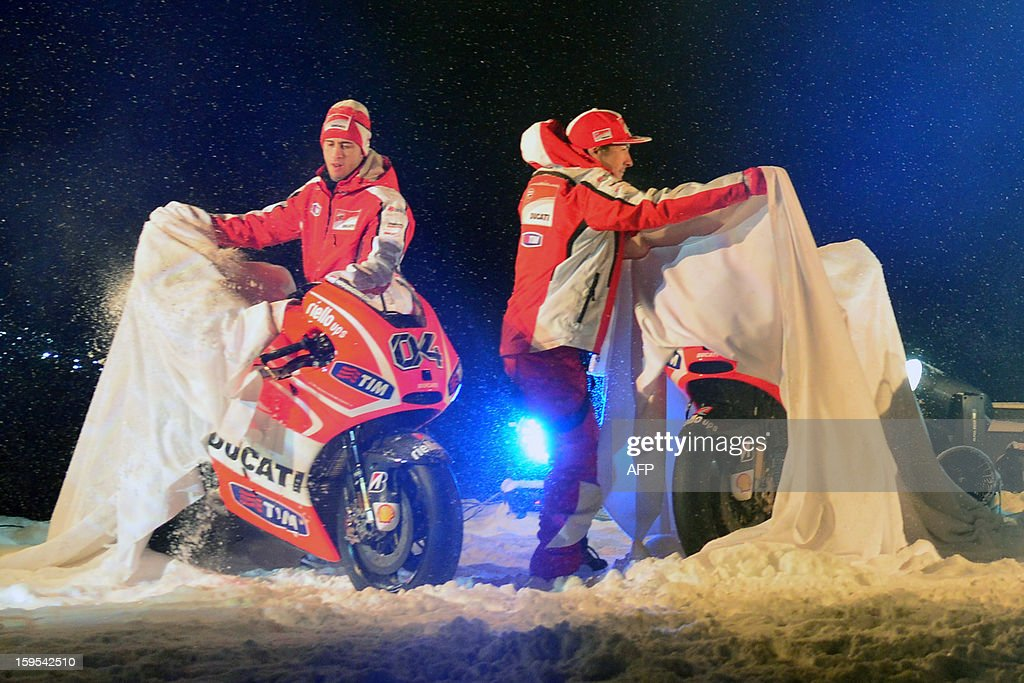 Ducati riders Nicky Hayden (R) and Andrea Dovizioso unveal their Ducati racing motorbikes during the Wrooom, F1 and MotoGP Press Ski Meeting, Ducati and Ferrari's annual media gathering, in Madonna di Campiglio on January 15, 2013.