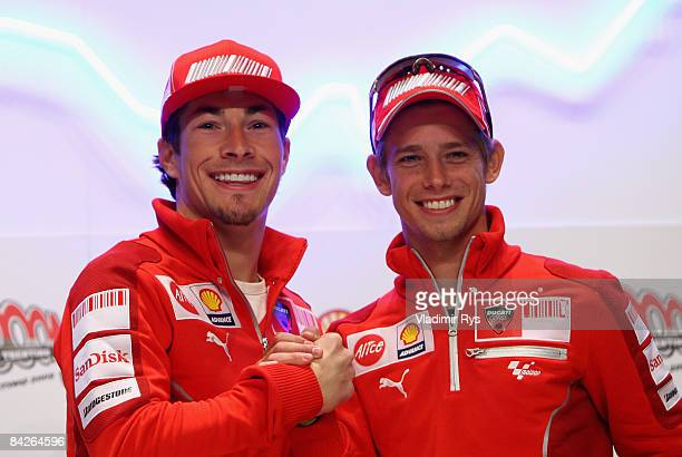 Ducati team mates Nicky Hayden of the USA and Casey Stoner of Australia pose for a picture during the WROOM F1 Press Meeting on January 13 2009 in...