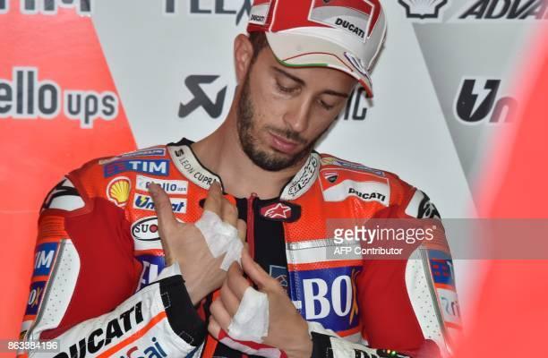 Ducati Team rider Andrea Dovizioso of Italy prepares for the second practice session of the Australian MotoGP Grand Prix at Phillip Island on October...