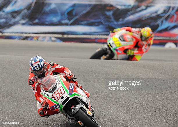 Ducati Team rider Nicky Hayden of the US and Ducati Team rider Valentino Rossi of Italy descend the Corkscrew during the free practice session at...