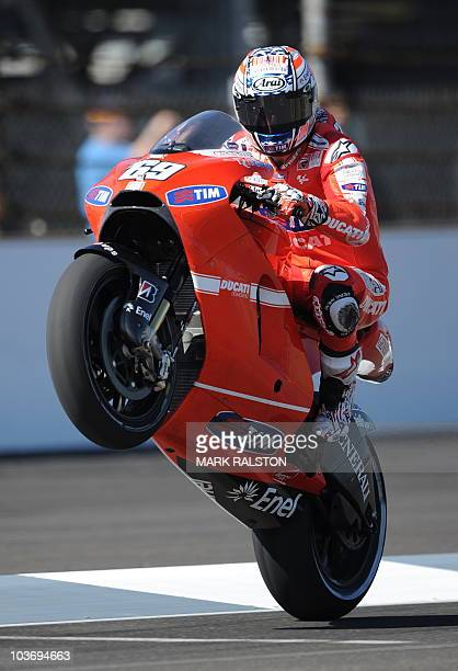 Ducati Team rider Nicky Hayden of the US does a wheelie before posting the fifth fastest time during the second MotoGP practice session of the Red...