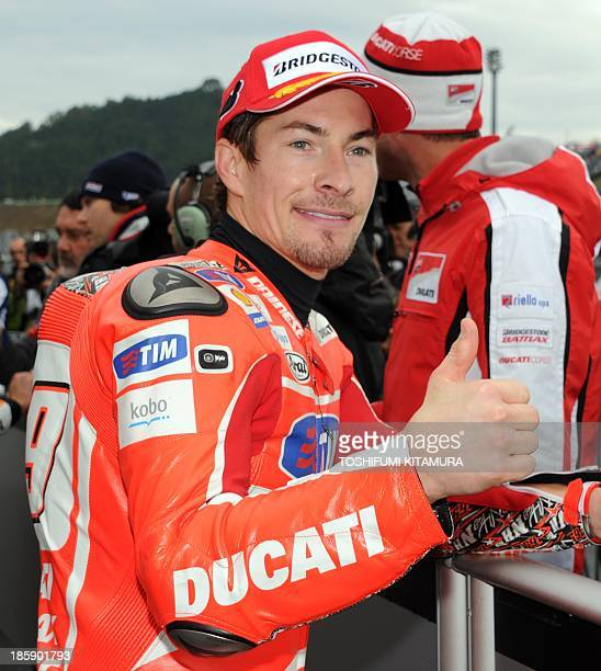 Ducati team rider Nicky Hayden of the US gestures at the parc ferme after the MotoGPclass qualifying session ahead of the Japanese MotoGP Grand Prix...