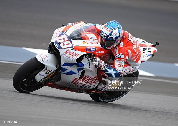 Ducati team rider Nicky Hayden of the US rides the fourth corner before finishing third in the MotoGP race at the Red Bull Indianapolis Grand Prix...