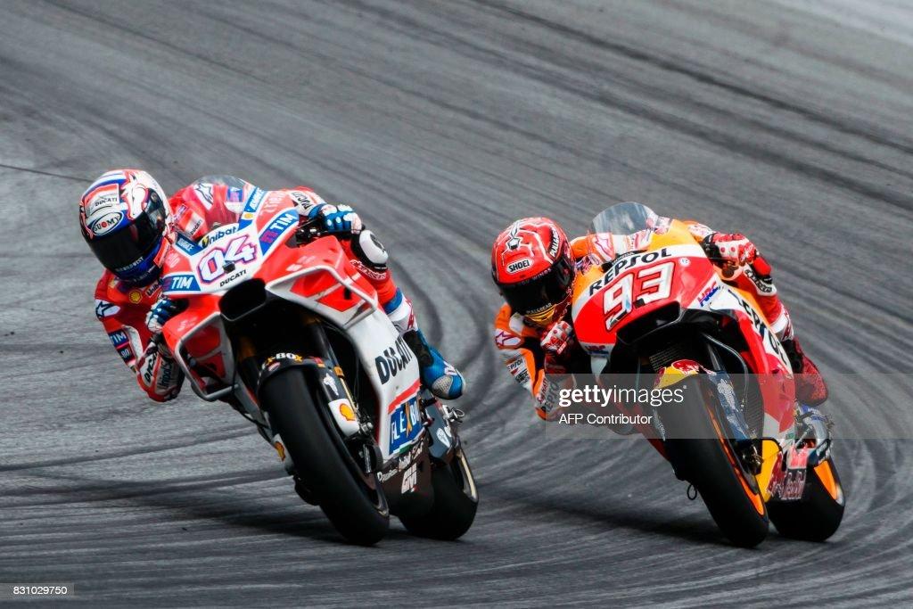 Ducati Team's Italian rider Andrea Dovizioso (L) and Repsol Honda Team's Spanish rider Marc Marquez compete during the MotoGP Austrian Grand Prix race at Red Bull Ring in Spielberg, Austria on August 13, 2017. / AFP PHOTO / Jure Makovec