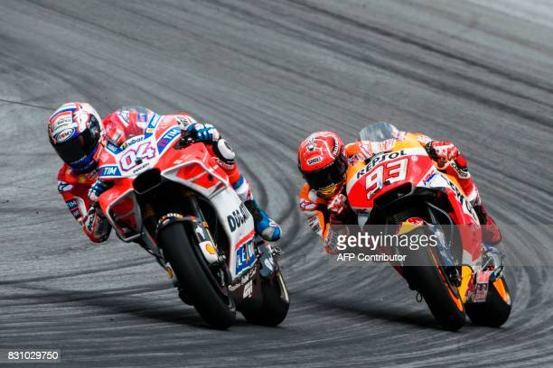 Ducati Team's Italian rider Andrea Dovizioso and Repsol Honda Team's Spanish rider Marc Marquez compete during the MotoGP Austrian Grand Prix race at...