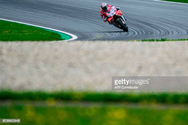 TOPSHOT Ducati Team's Italian rider Andrea Dovizioso competes during the first practice session of the MotoGP Austrian Grand Prix weekend at the Red...