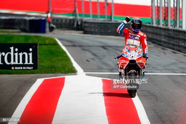 Ducati Team's Italian rider Andrea Dovizioso crosses the finish line after the the MotoGP Austrian Grand Prix race at Red Bull Ring in Spielberg...