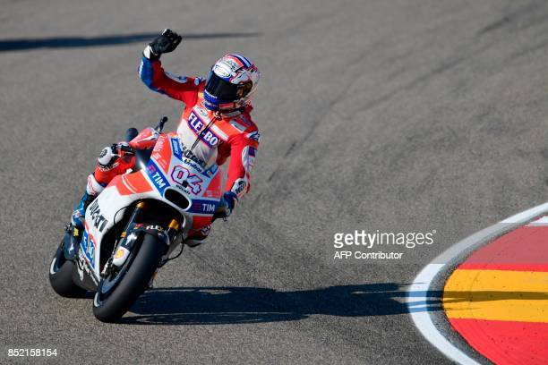 Ducati Team's Italian rider Andrea Dovizioso greets from his bike after the Moto GP third free pratice of the Moto Grand Prix of Aragon at the...