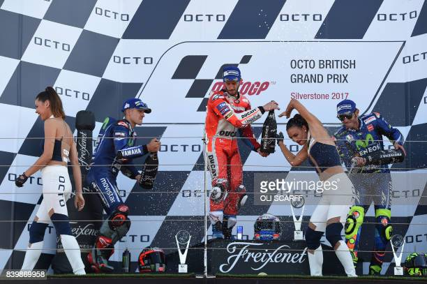 Ducati Team's Italian rider Andrea Dovizioso in first place Movistar Yamaha MotoGP's Spanish rider Maverick Vinales in second place and Movistar...