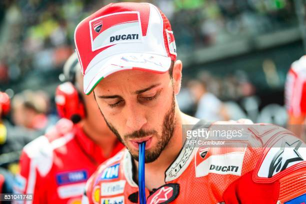 Ducati Team's Italian rider Andrea Dovizioso prepares on grid for the start MotoGP Austrian Grand Prix race at Red Bull Ring in Spielberg Austria on...