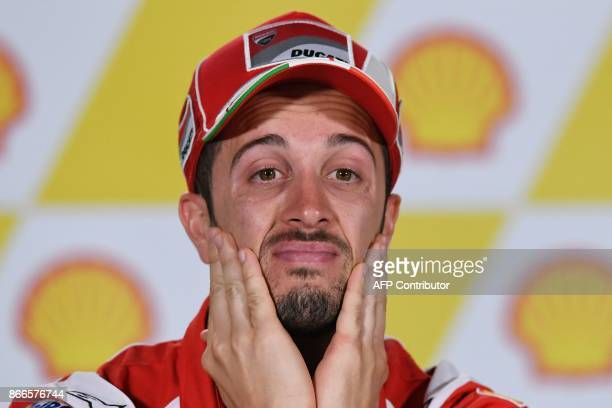 Ducati Team's Italian rider Andrea Dovizioso reacts during a press conference ahead of the Malaysia MotoGP at the Sepang International circuit in...