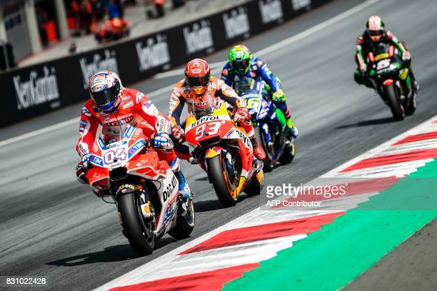 Ducati Team's Italian rider Andrea Dovizioso Repsol Honda Team's Spanish rider Marc Marquez Movistar Yamaha MotoGP's Italian rider Valentino Rossi...