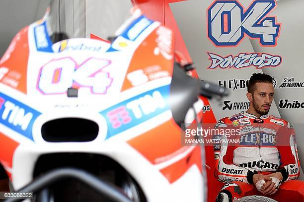 Ducati Team's Italian rider Andrea Dovizioso sits in the team's garage during the first day of 2017 MotoGP preseason test at the Sepang International...